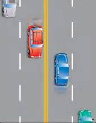When there are four or more lanes with traffic moving in opposite directions, two solid yellow lines mark the: